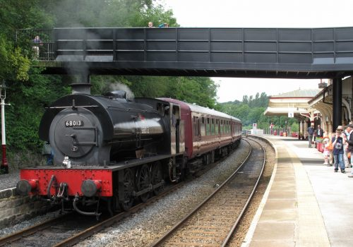 Matlock_station_with_Peak_Rail_train_hauled_by_Hunslet_Austerity_0-6-0ST_68013,_July_2012